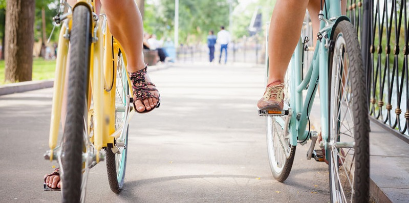 Two Bicyclists Riding Together